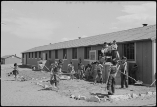Granada_Relocation_Center_Amache_Colorado._View_showing_Elementary_children_landscaping_the_groun_._._._-_NARA_-_539398
